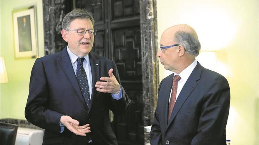 Puig se reúne con Montoro para tratar avances en la financiación