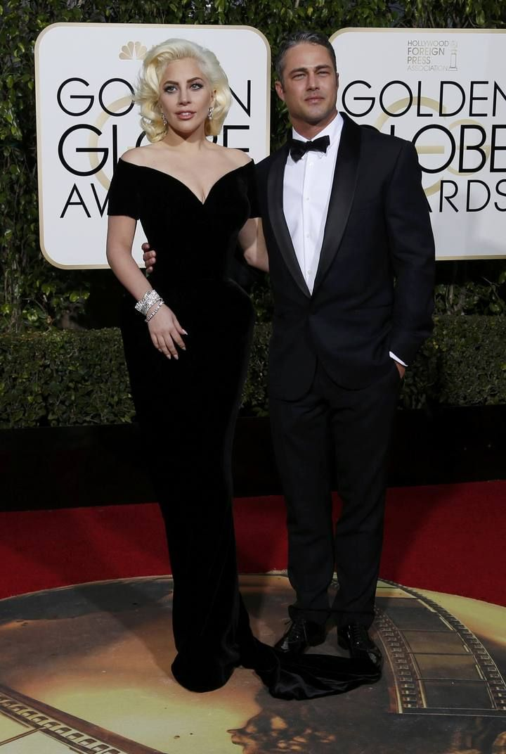 Singer Lady Gaga arrives with finance Taylor Kinney at the 73rd Golden Globe Awards in Beverly Hills