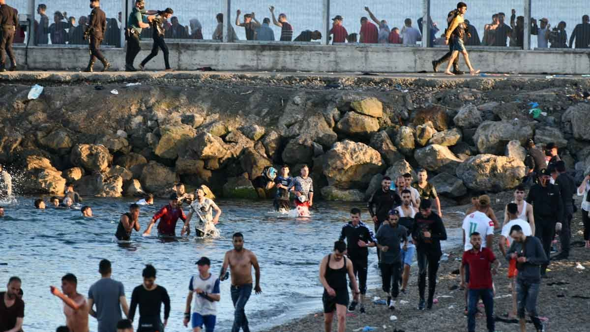 Migrants cross from Morocco to Spain through the enclave of Ceuta.