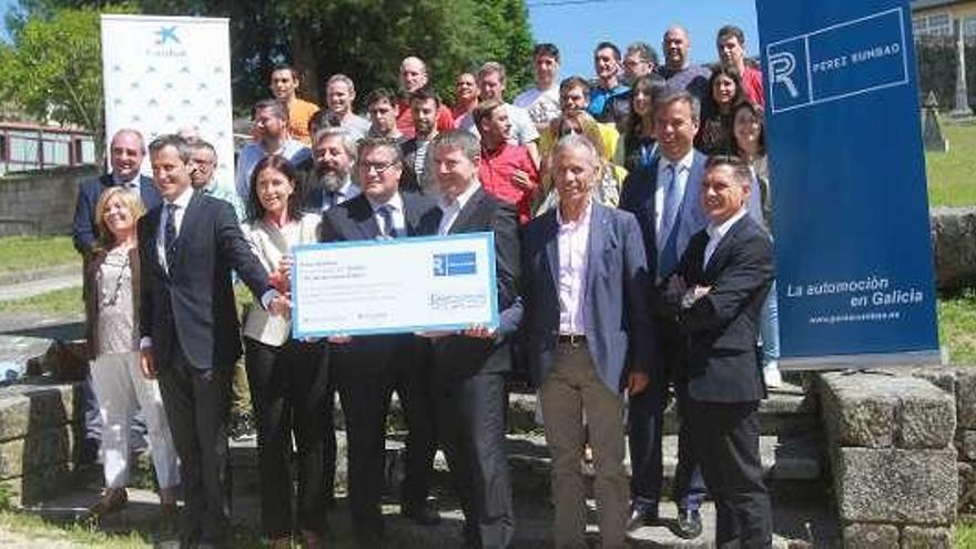 Rumbao y CaixaBank donan 20.000 euros a Proxecto Home y Autismo