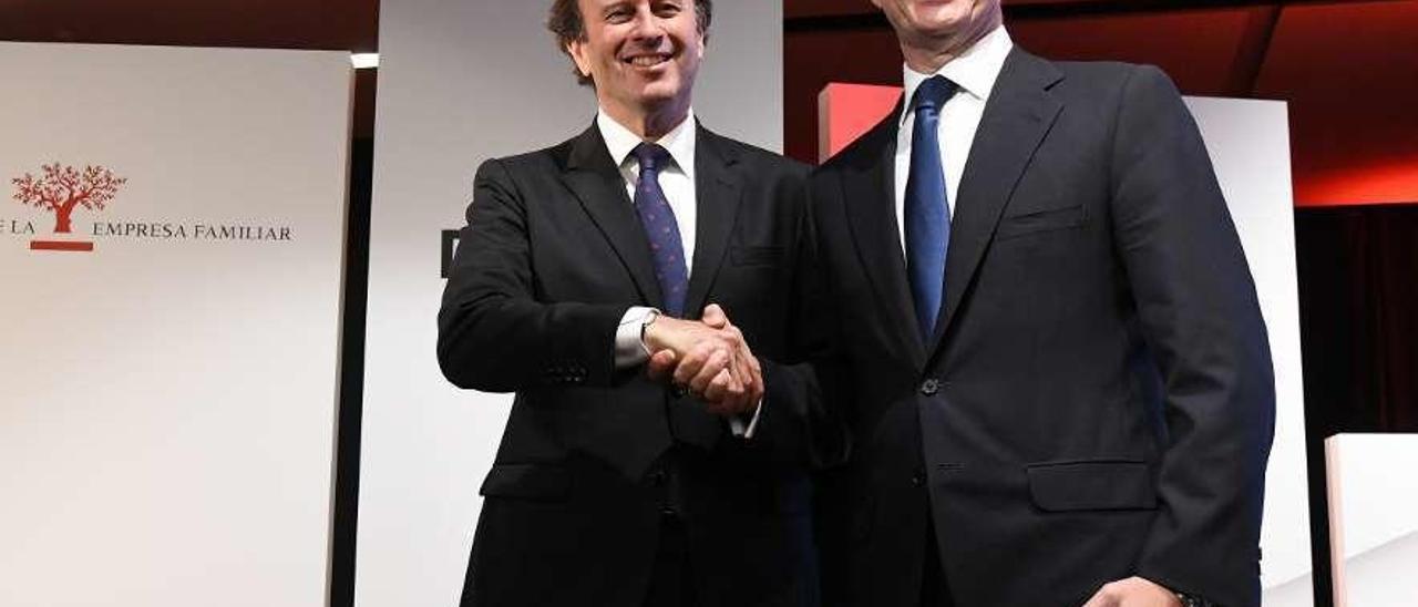 Ignacio Osborne (izquierda) y Francisco Riberas, ayer, en el encuentro de la empresa familiar, en Barcelona. // L.O.