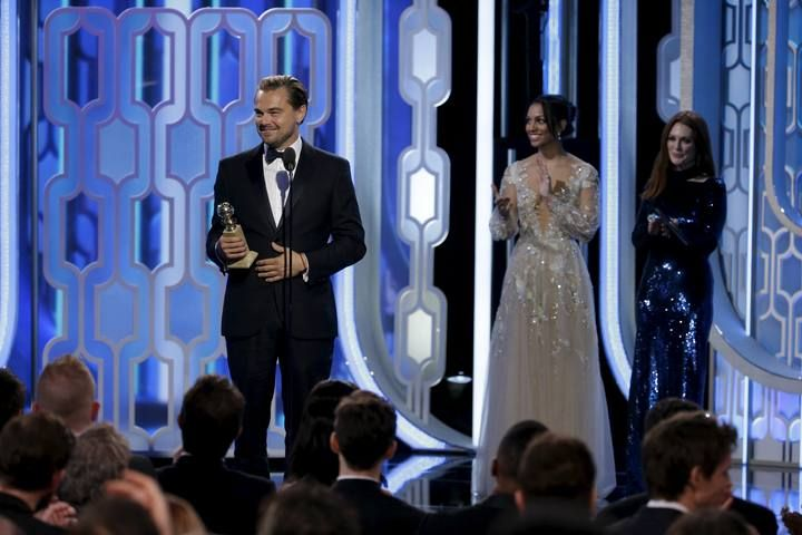 """Handout photo of Leonardo DiCaprio holding his award for Best Actor, Motion Picture, Drama, for """"The Revenant"""" at the 73rd Golden Globe Awards in Beverly Hills"""