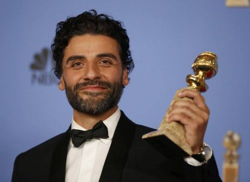 "Oscar Issac poses with the award for Best Performance by an Actor in a Limited Series or a Motion Picture Made for Television for his role in ""Show Me a Hero"" backstage at the 73rd Golden Globe Awards in Beverly Hills"