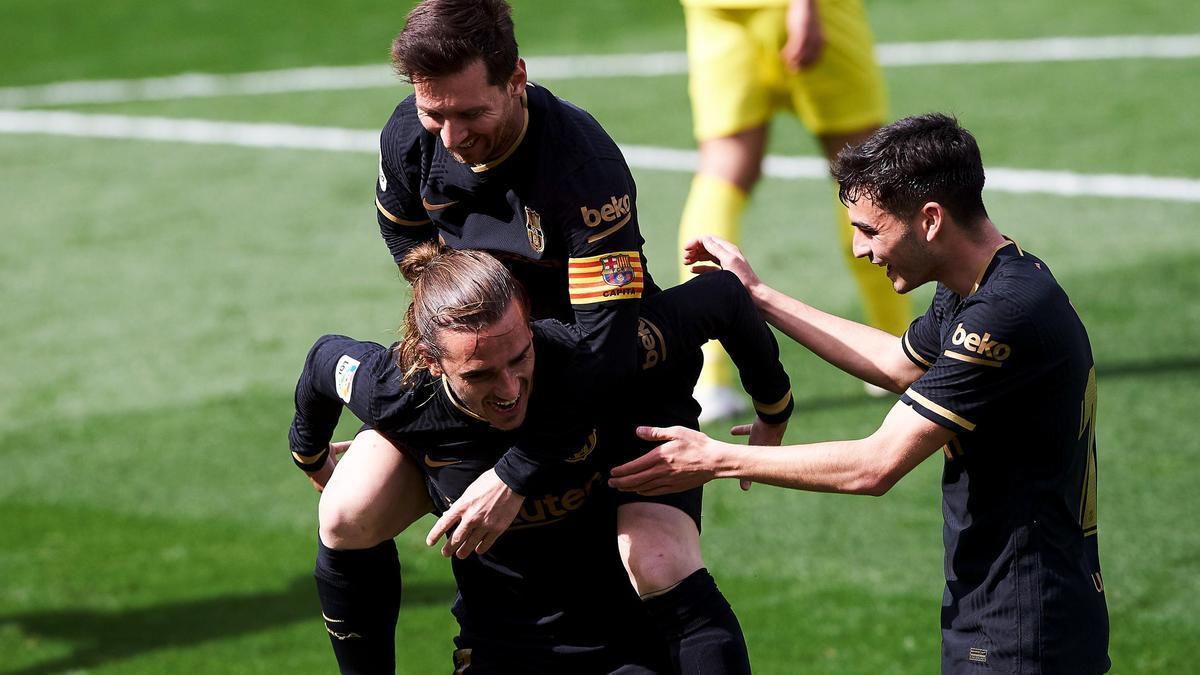 Griezmann y Messi celebran uno de los dos goles del francés.