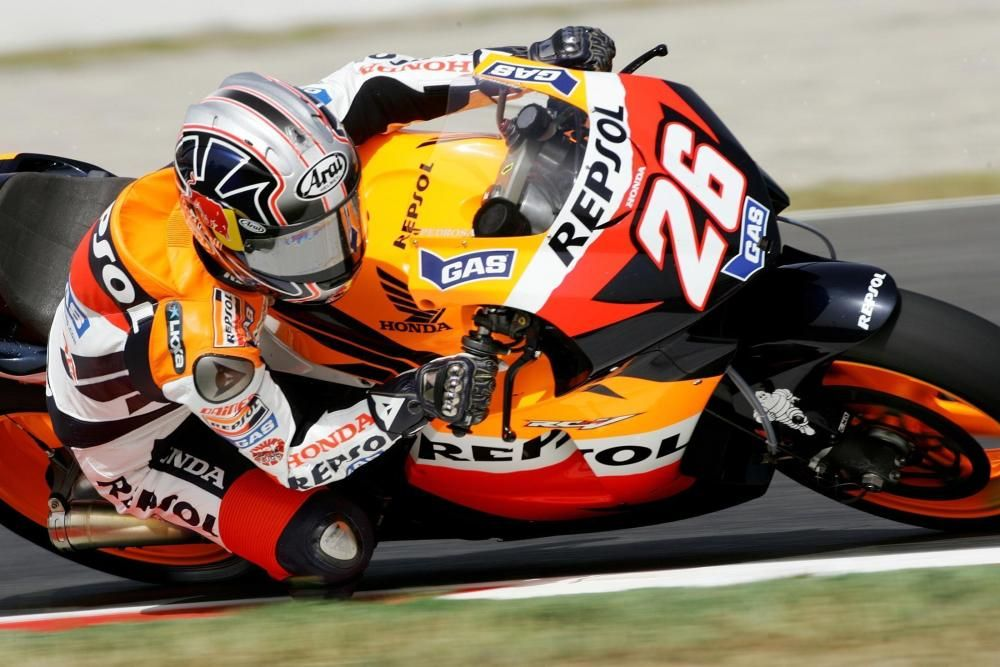 Honda MotoGP rider Pedrosa of Spain takes curve ...