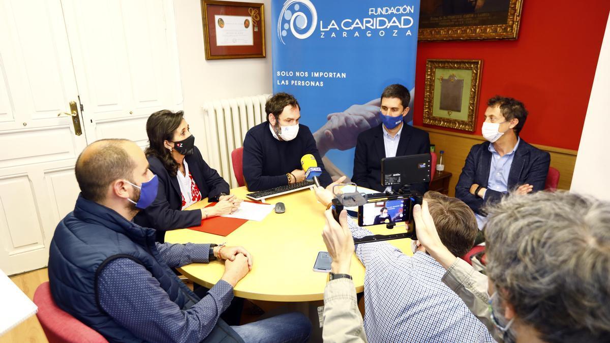 Los representantes de la Fundación La Caridad.