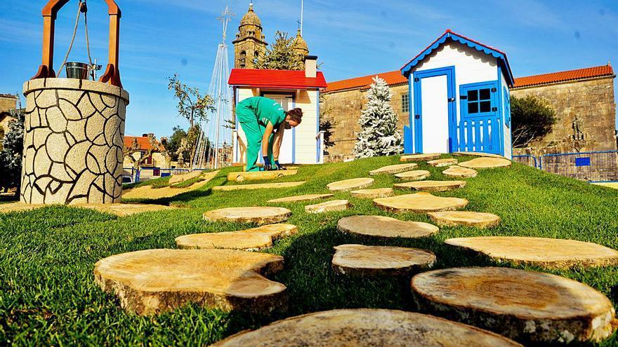 El comercio cambadés potencia el ambiente festivo con docenas de árboles a las puertas de los negocios
