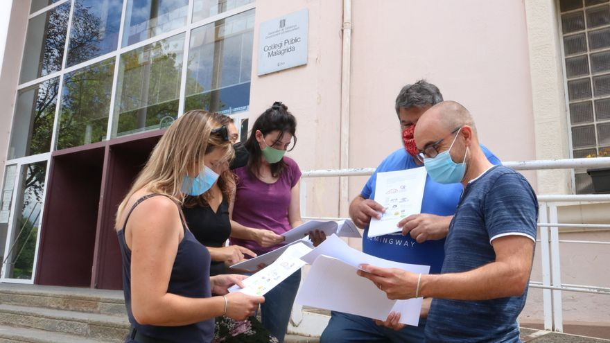 """Famílies de l'escola Malagrida i Pla de Dalt d'Olot denuncien que el Consell els vol """"expropiar"""" el servei de menjador"""