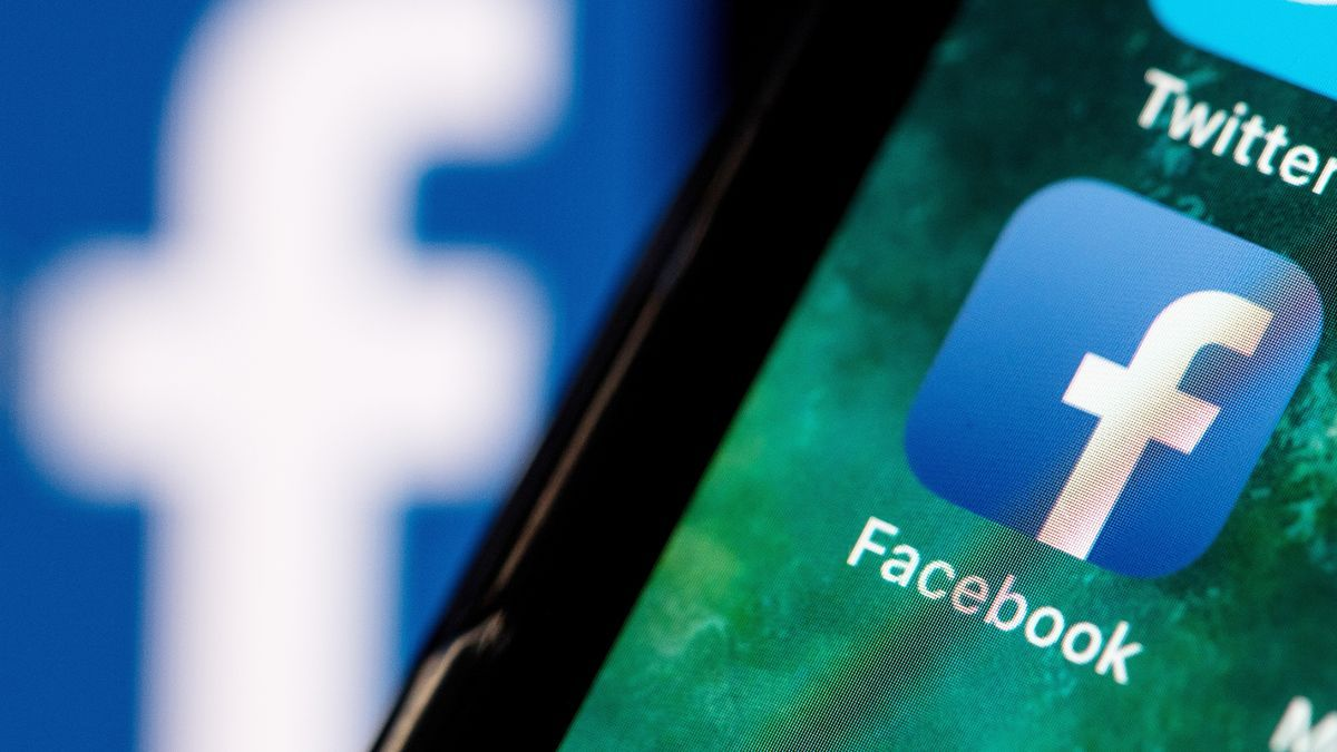 The Facebook logo on a mobile in a stock image.