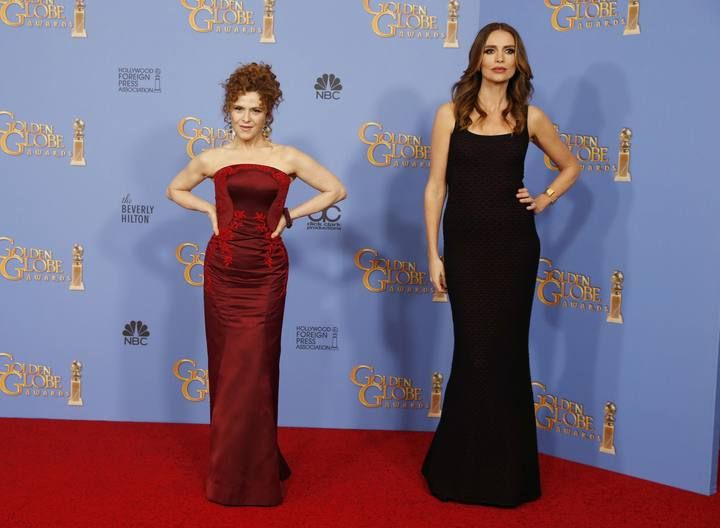 Actresses Peters and Burrows pose backstage at the 73rd Golden Globe Awards in Beverly Hills