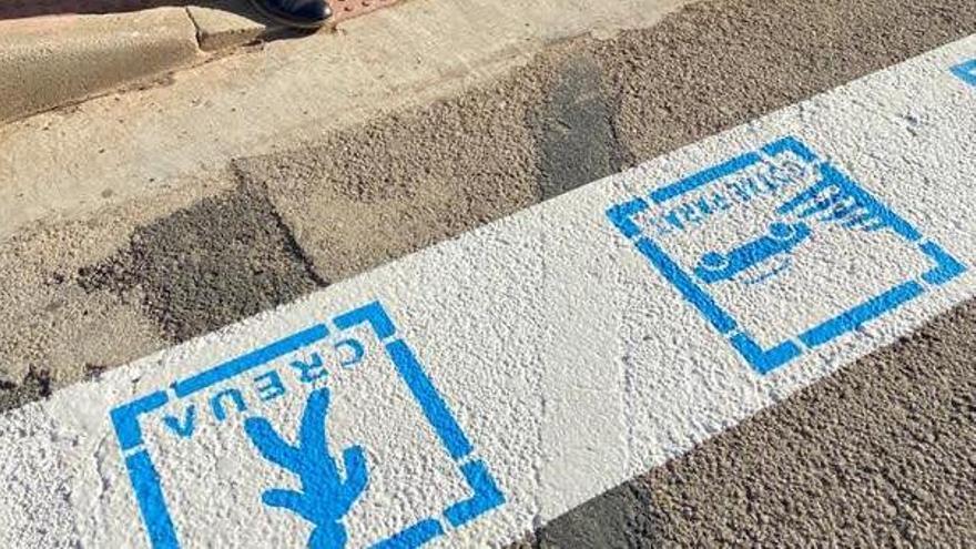 Frases educativas y pictogramas dirigidos a personas con TEA en los pasos de peatones de Burjassot