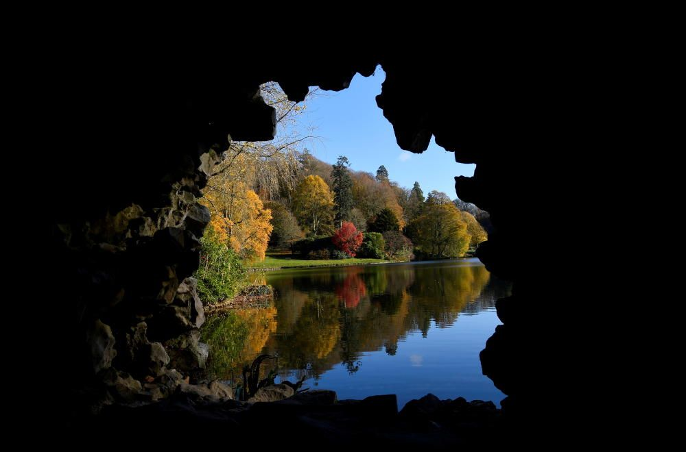 Autumn foliage is seen at Stourhead gardens, ...