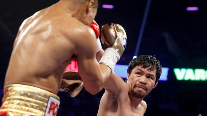 Pacquiao arrebata el título welter a Vargas en su regreso