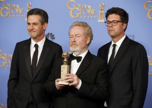 Ridley Scott, Simon Kinberg and Michael Scheafer pose with their award during the 73rd Golden Globe Awards in Beverly Hills