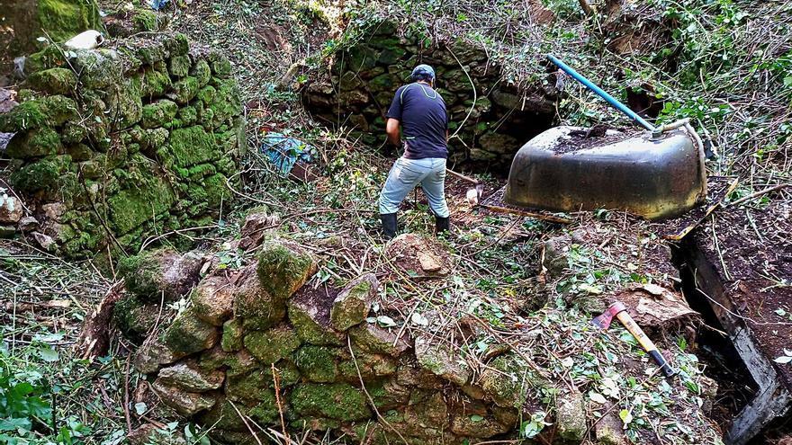Cesantes plantea una senda para rescatar los molinos en el curso del río Pexegueiro