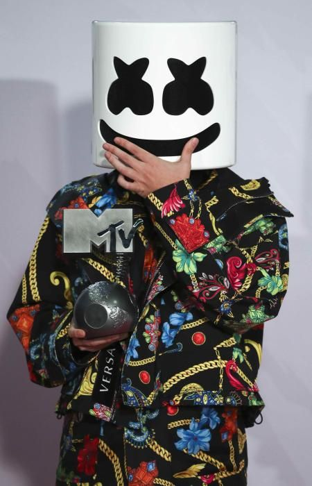 Music producer and DJ Marshmello poses with his ...