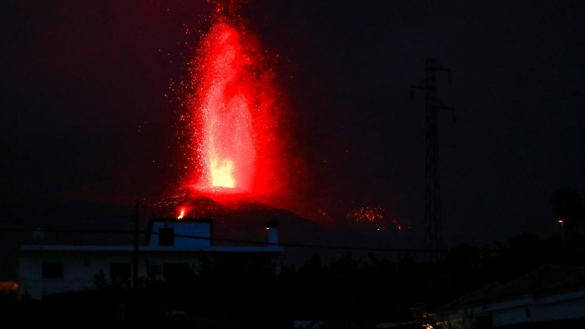 Lava and smoke rise following the eruption of a volcano on Spanish Canary Island of La Palma