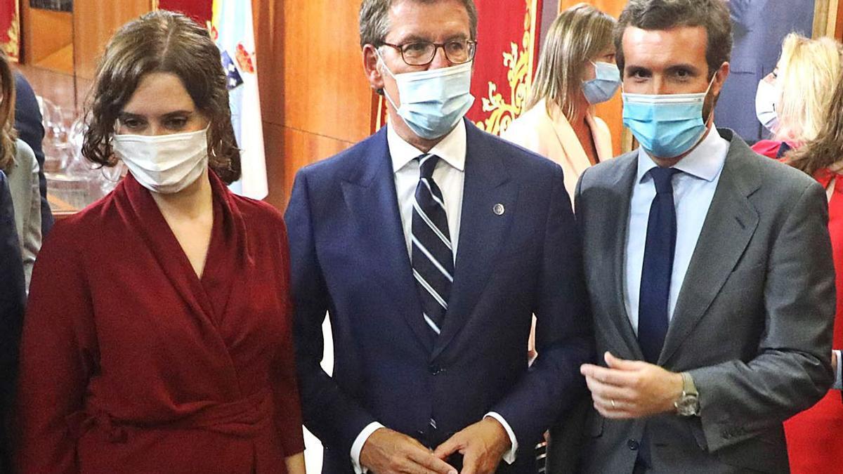 Ayuso, Feijóo y Casado, en la toma de posesión del segundo el pasado septiembre. |   // XOÁN ÁLVAREZ