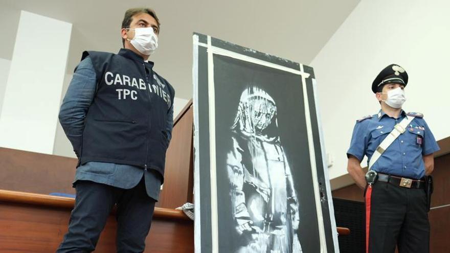 Recuperan en Italia una puerta robada de la sala Bataclan con un mural de Banksy