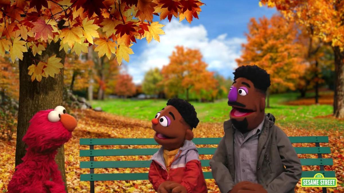 Wes y Elijah, junto a Elmo en Barrio Sésamo.