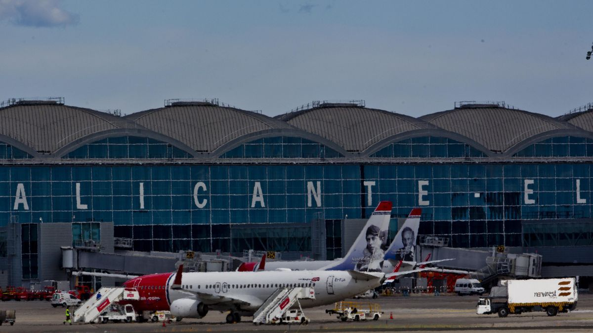 Norwegian planes on the airport parking apron in a stock image