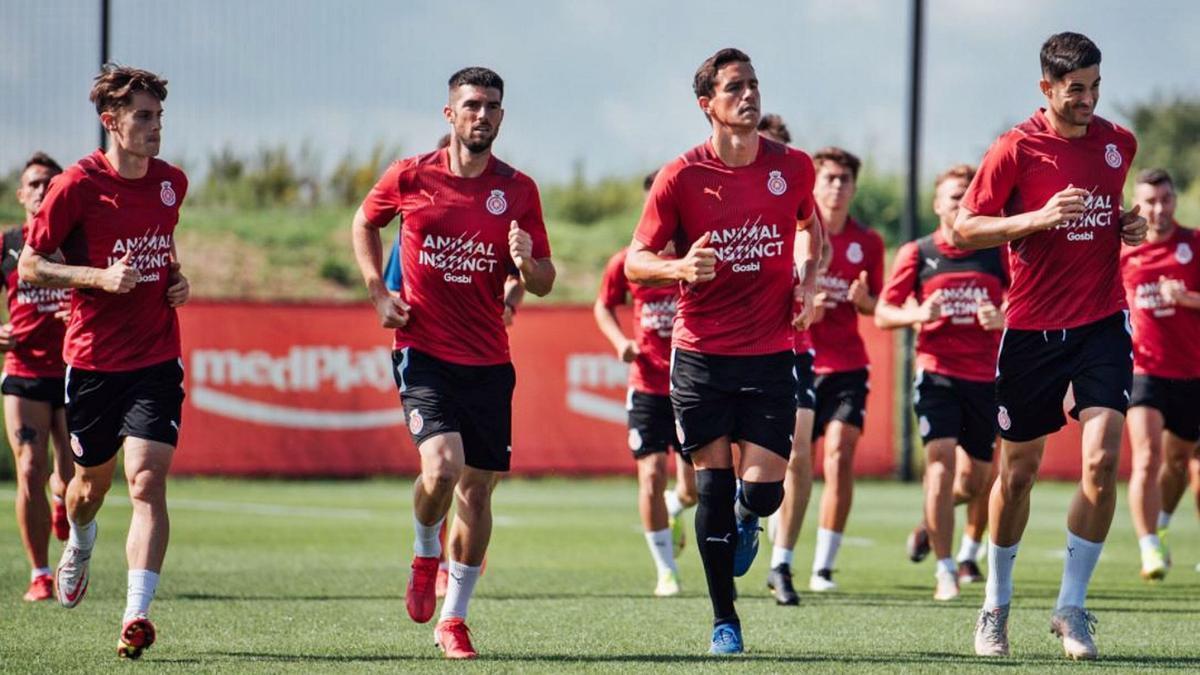 Pol Lozano, Calavera,  Bernardo i Juanpe, durant  l'entrenament d'ahir a La  Vinya.    GIRONA FC