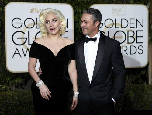 Singer Lady Gaga arrives with fiance Taylor Kinney at the 73rd Golden Globe Awards in Beverly Hills