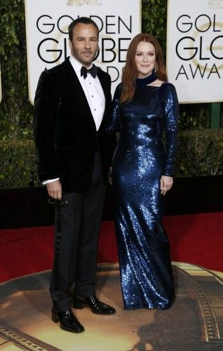 Fashion designer Ford arrives with actress Moore at the 73rd Golden Globe Awards in Beverly Hills