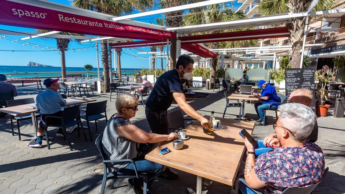 A waiter attends a terrace in Benidorm