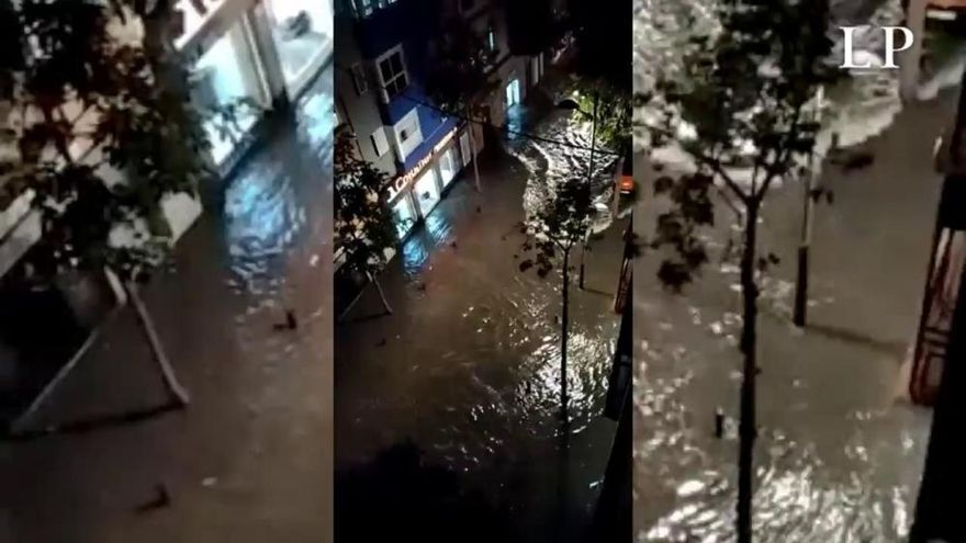 Una tromba de agua anega negocios, calles y atrapa a vecinos en Gran Canaria
