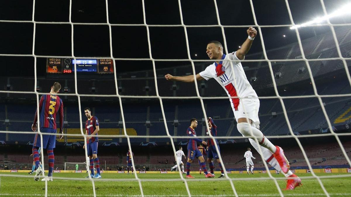 Mbappé celebrates a goal at the Camp Nou.