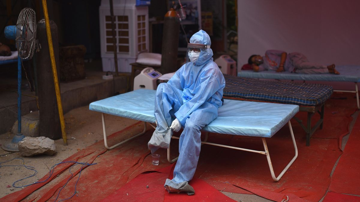 A male nurse putting on the PPE suit in India.