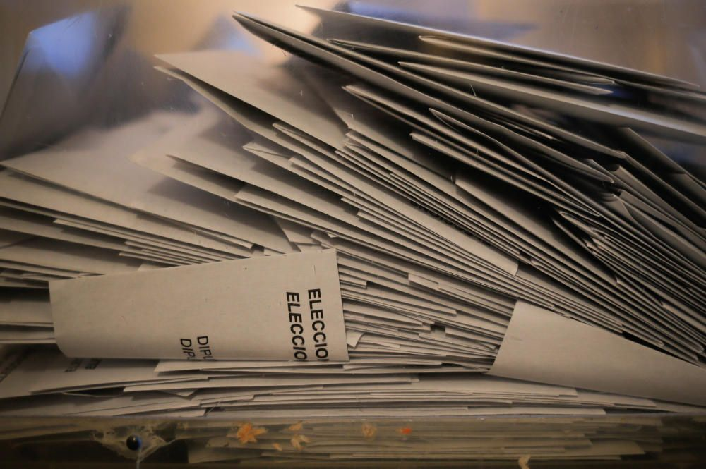 Envelopes containing ballots are seen inside a ...