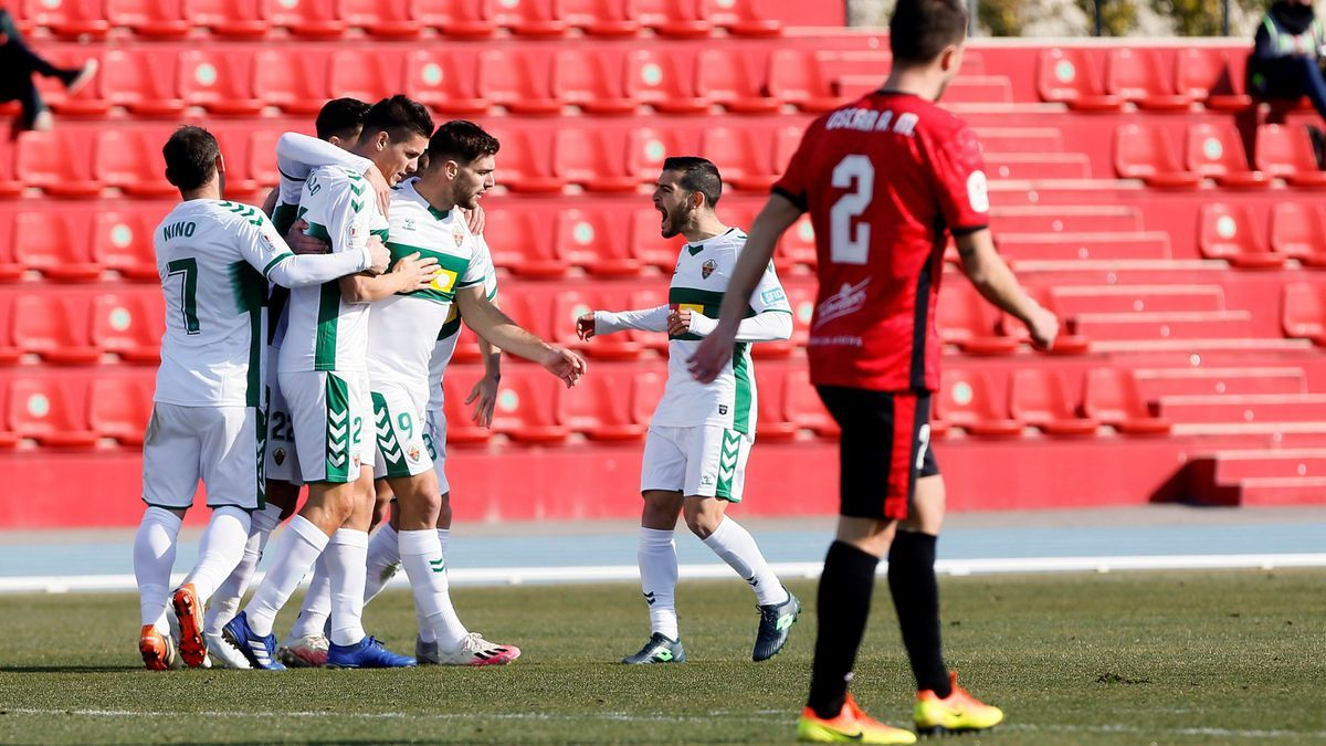 Elche players celebrate the goal