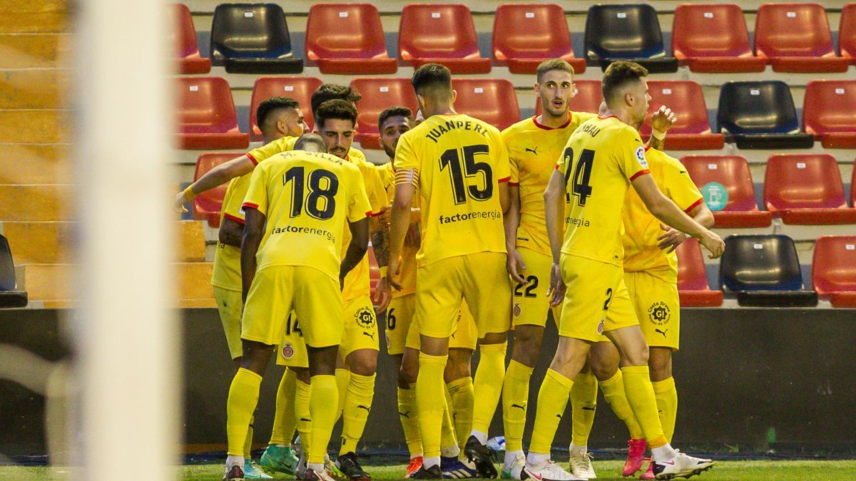 Girona players celebrate one of the goals against Rayo