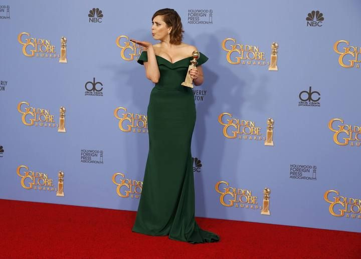 """Rachel Bloom poses with her award for Best Performance by an Actress in a Television Series - Musical or Comedy for her role in """"Crazy Ex-Girlfriend"""" backstage at the 73rd Golden Globe Awards in Beverly Hills"""