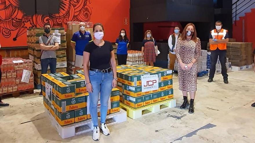 El club Track and Fiel dona 1.300 litros de leche al Banco de Alimentos