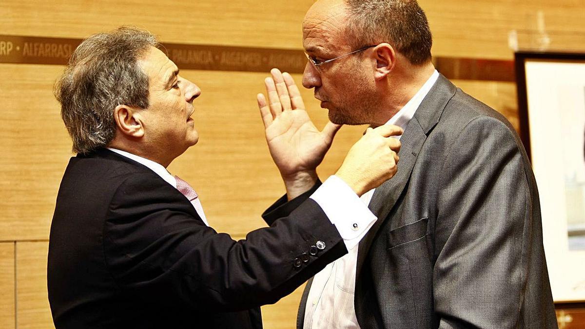 Alfonso Rus y Rafael Rubio, en una imagen de 2008, en un pleno de la Diputación de València. | FERRAN MONTENEGRO