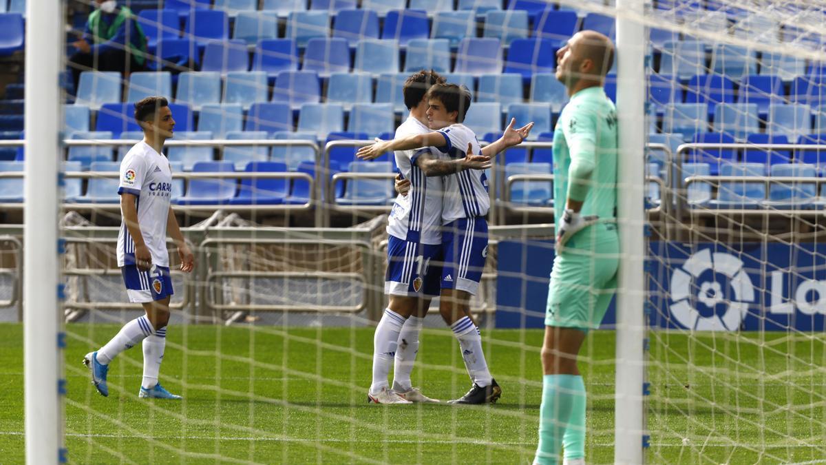 Francho, Eguaras y Bermejo celebran uno de los dos goles marcados al Almería.