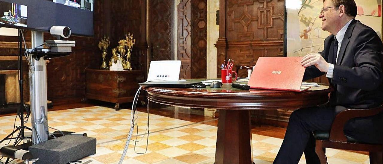 Un momento de la reunión telemática de Ximo Puig con Antonio Garamendi y Salvador Navarro.