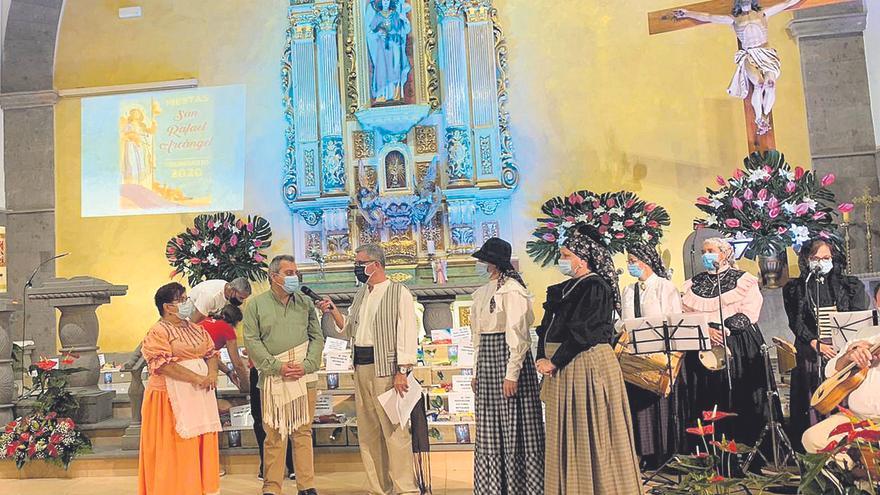 Vecindario celebra San Rafael con una ofrenda solidaria