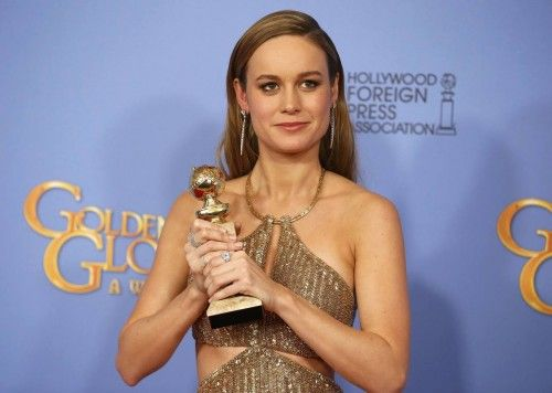 Brie Larson poses with her award during the 73rd Golden Globe Awards in Beverly Hills